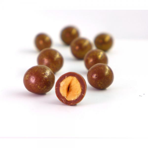 Čokoladne kroglice obliti lešniki z medeno čokolado